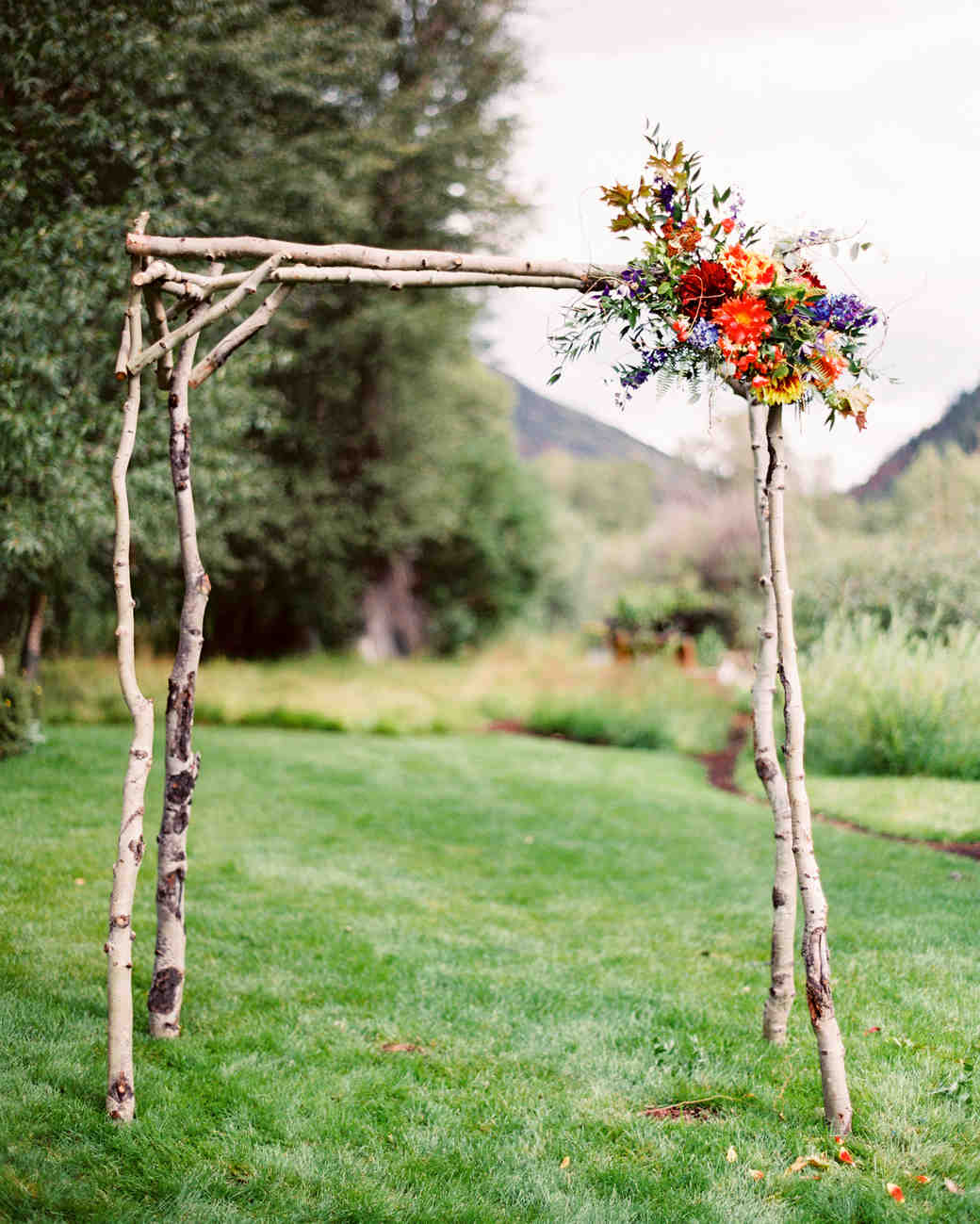 Simple Wooden Wedding Arch with Colorful Flower Bouquet