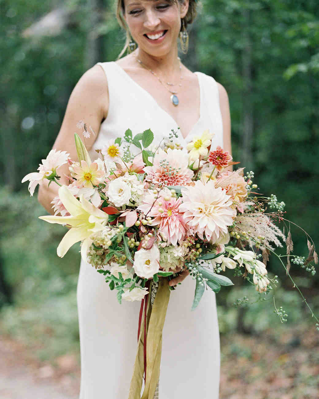 Rustic Bridal Bouquet with Foliage, Berries, and Peachy Flowers
