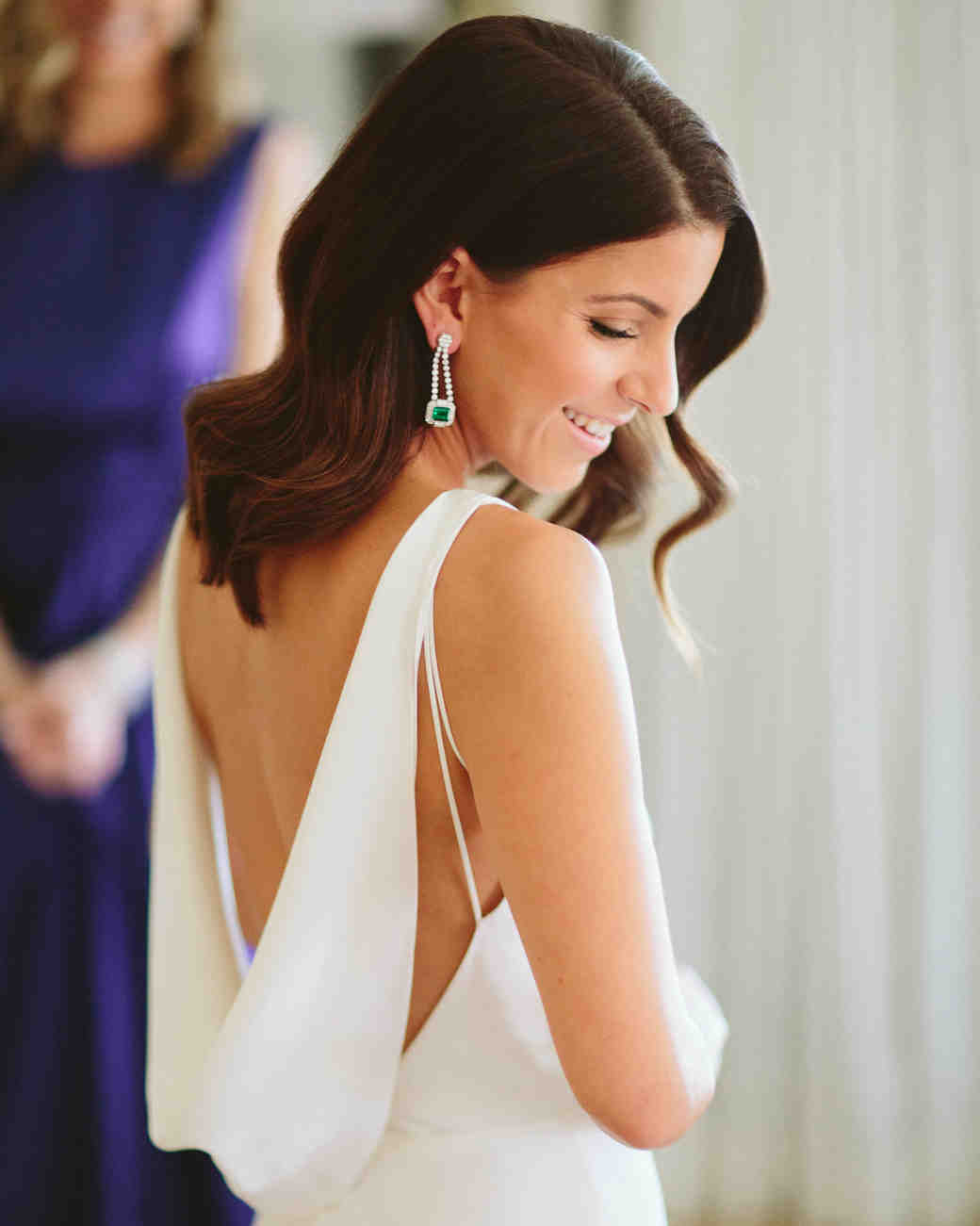 A Bride with a Wedding Dress with a Low Open Back