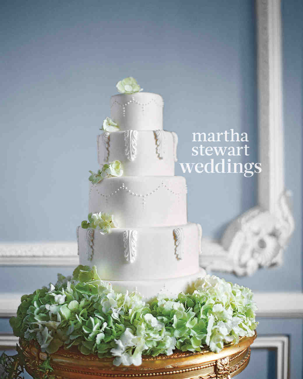 Five-Tiered White Wedding Cake with Green Flowers and French Architectural Molding