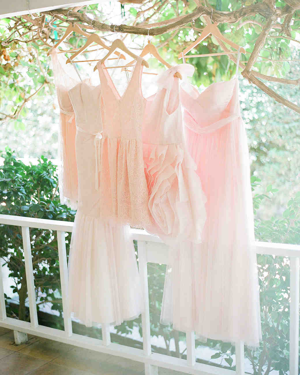 Light Pink Bridesmaid Dresses Hanging Off Branch