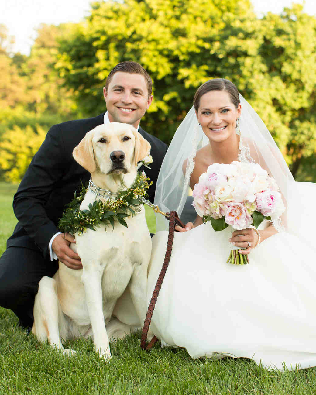 A Happy Newlywed Couple with Their Dog
