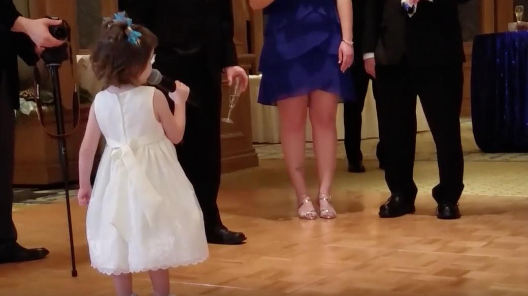 little girl giving wedding toast