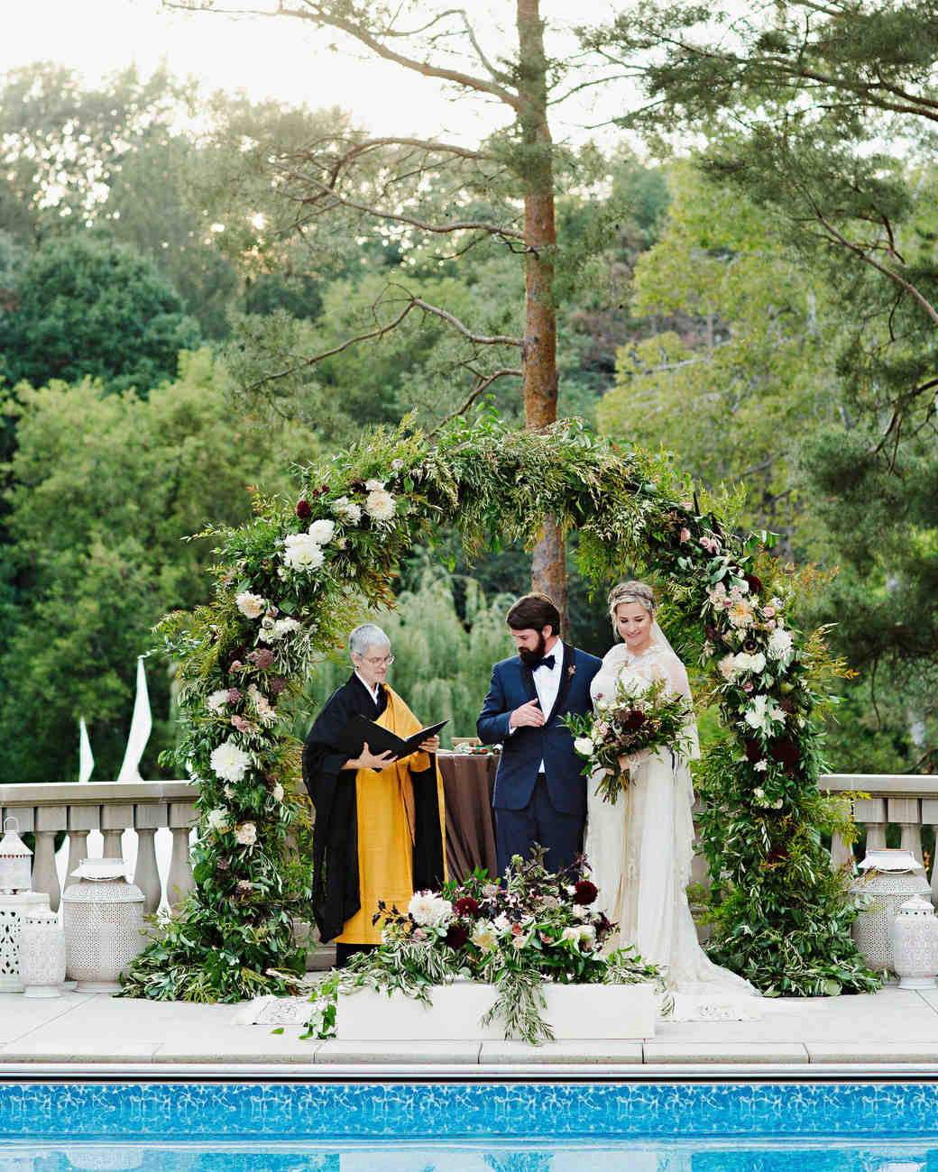 Lush Flowering Wedding Arch with Lots of Greenery