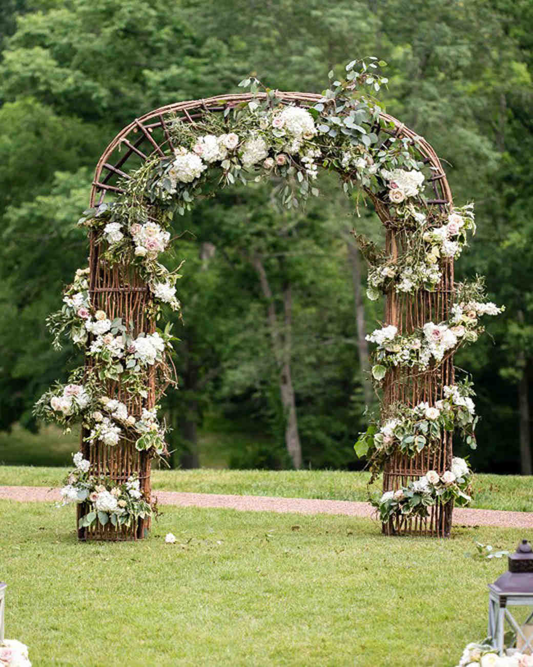 Wirey Wooden Chuppah with Wrap-Around Flowers and Foliage