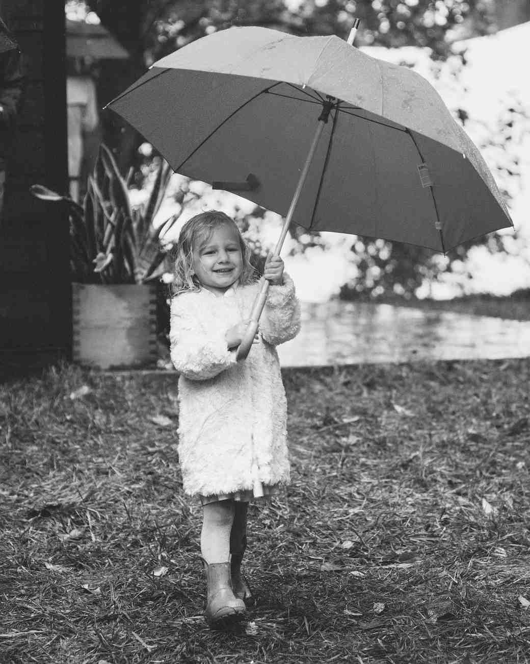 jessie tristan wedding tennessee child guest umbrella