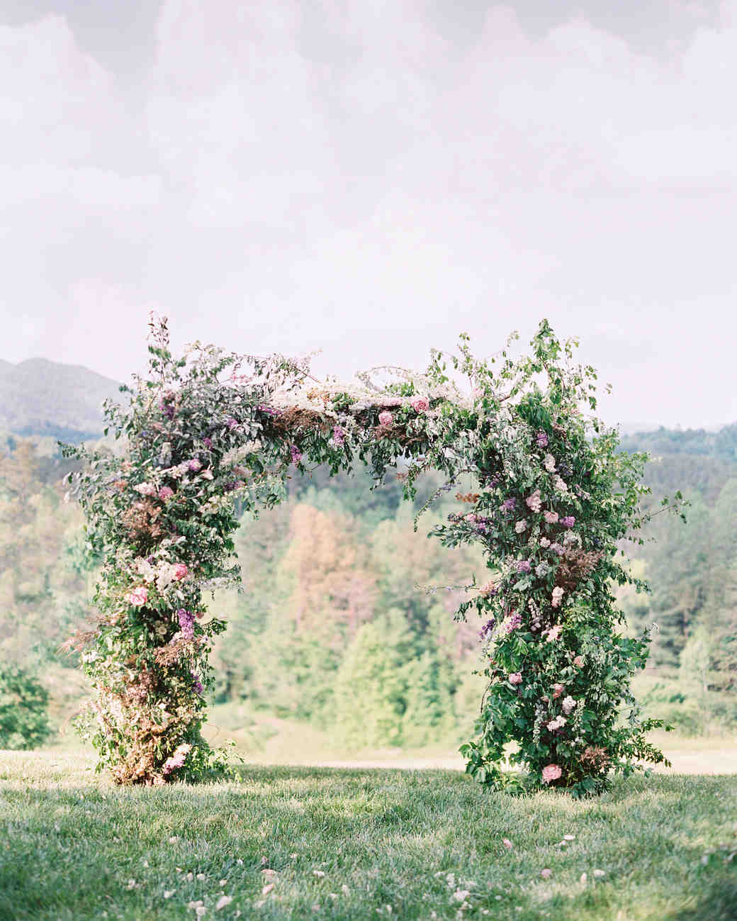 Floral Wedding Arch with Pink Flowers and Lush Greenery