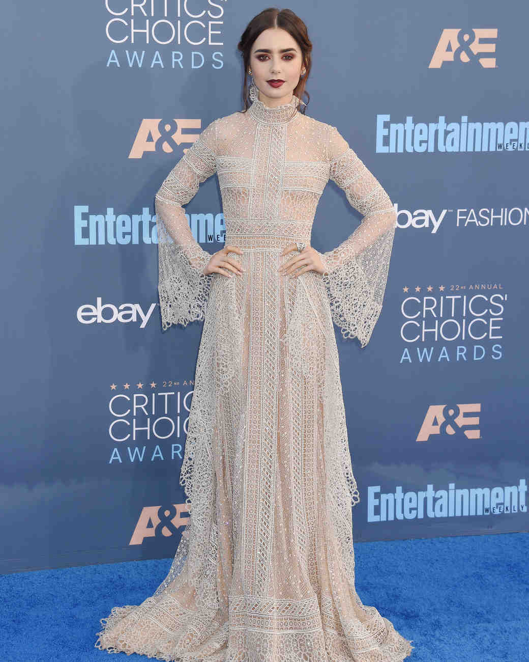 The year-old actress and singer was one of the first celebs to walk the red carpet. She wore a fiery Giambattista Valli dress, Jimmy Choo shoes, and a Chopard necklace.