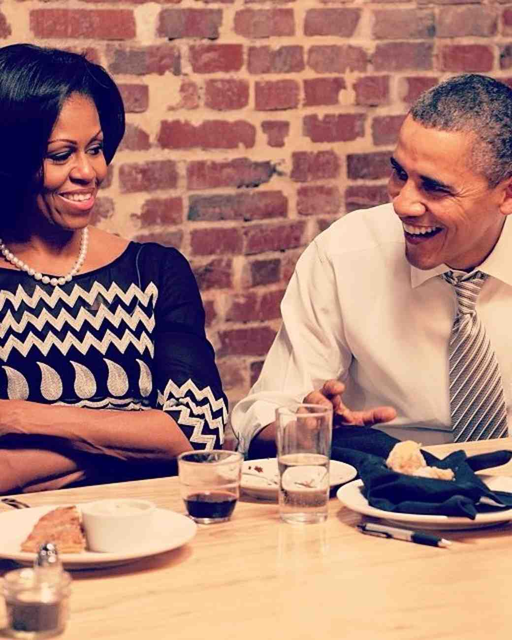 Michelle and Barack Obama Laughing at Dinner