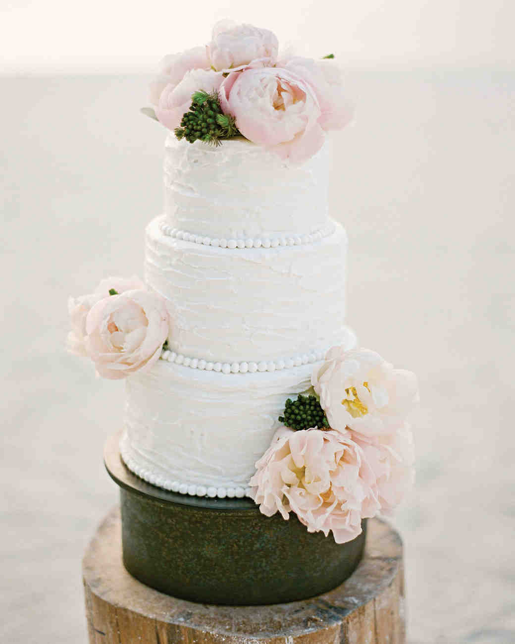 Three-Tiered White Wedding Cake with Blush Peonies and Icing Beading