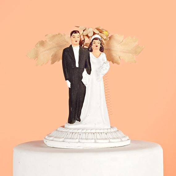 vintage wedding couple with foliage cake topper