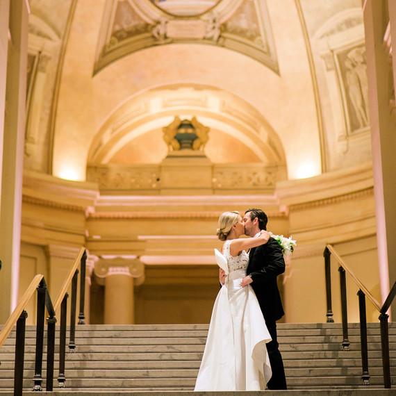 wedding couple in church kissing