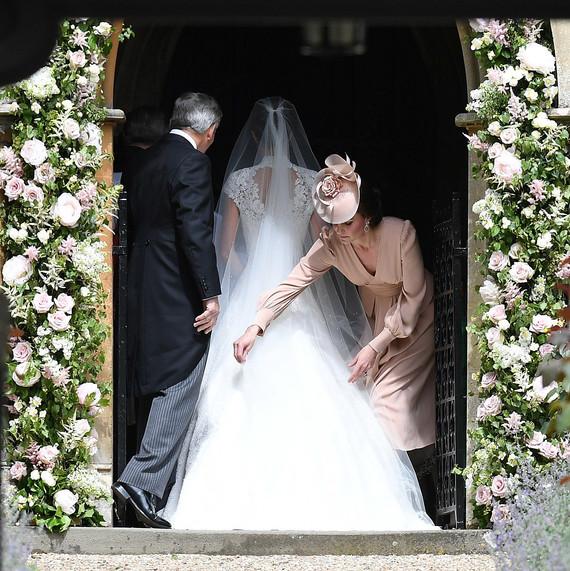 Duchess Kate adjusting Pippa Middleton wedding dress
