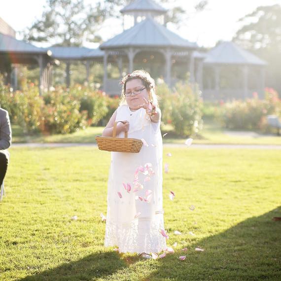 survivor flower girl wedding tossing petals