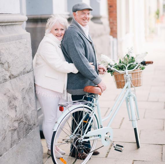 anniversary photo shoot andy margaret hugging bike