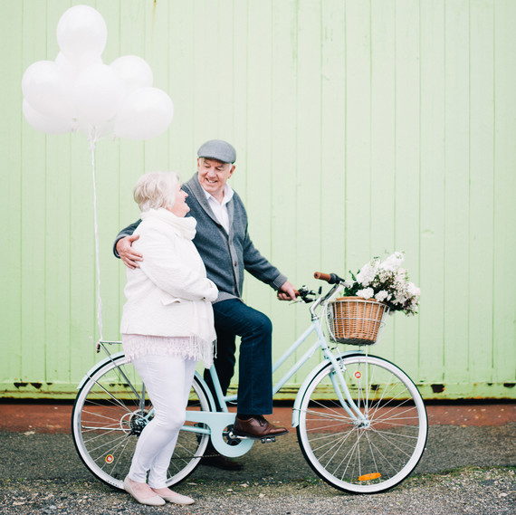 anniversary photo shoot andy margaret bike green wall