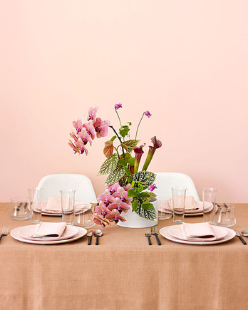 ikebana floral centerpiece on table