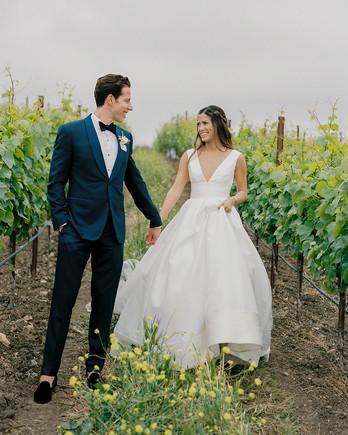 mika steve wedding couple walking in vinneyard