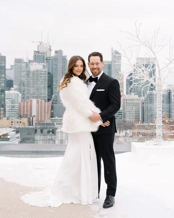krista will wedding couple outside fur coat cityscape