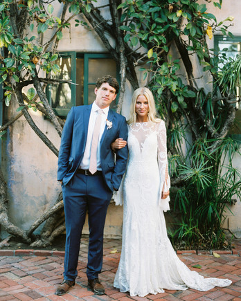 maddie will wedding couple in front of trees in courtyard