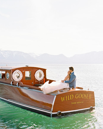 asha andrew wedding couple in boat on lake tahoe