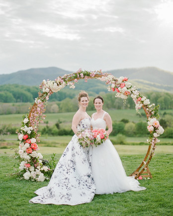 mechelle julia wedding couple brides ceremony arch