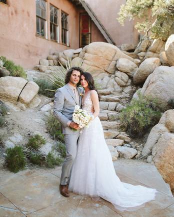 ashley basil wedding couple on rocky steps