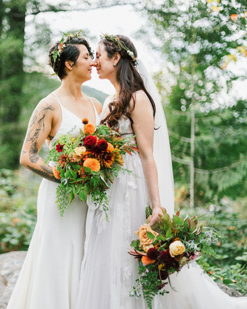 brides pose for wedding portraits outside in forest
