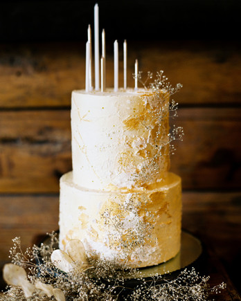 white and gold wedding cake adorned with painted constellations