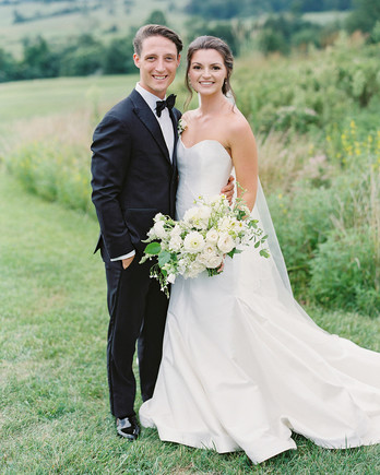wedding couple posing for portrait on Virginia farm