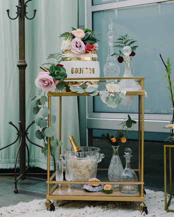 wedding bar cart featuring bourbon