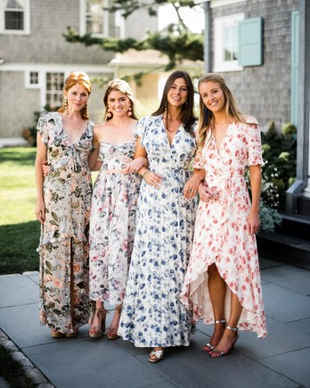 chic bridesmaids long floral dresses with earrings