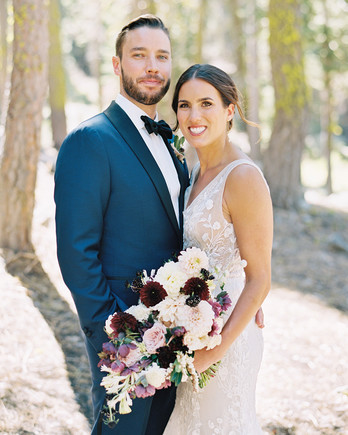 wedding couple portrait outdoors with lush bouquet