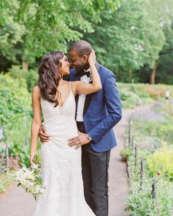 wedding couple posing for portrait at park