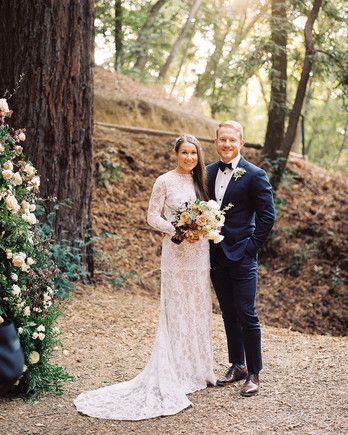 portrait of wedding couple in red wood forest