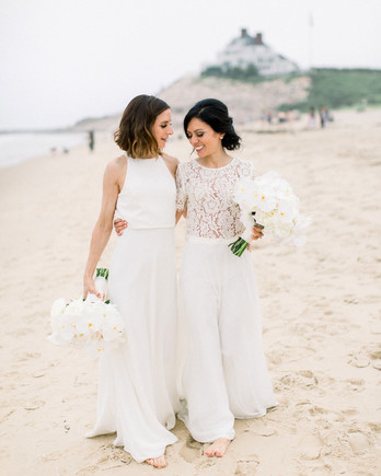brides walk on ocean front beach