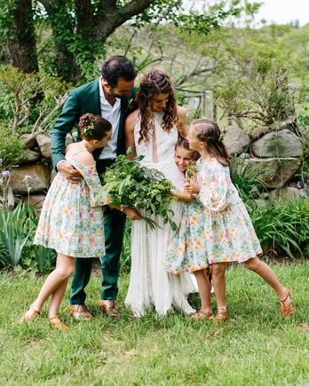 molly ed wedding family hug bride groom daughters