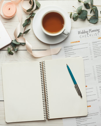 Wedding Planning Checklist and Laptop