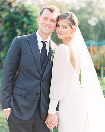 samantha cody wedding couple smiling and holding hands