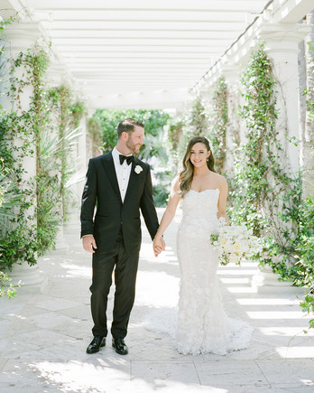 brittany brian wedding couple walking through stone garden structure