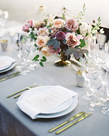 compote centerpieces pastel pink and purple bouquet with grey tablesetting