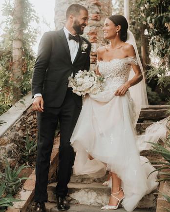 jaclyn antonio wedding couple walking downstairs