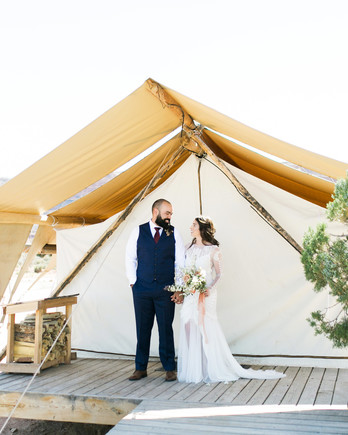 jeanette david wedding couple under tent