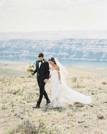 micaela curtis wedding couple walking through field