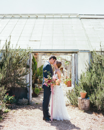 bride groom kiss outdoors greenhouse wedding space