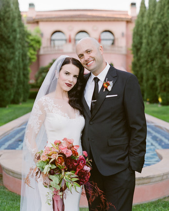 wedding couple posing in front of san diego hotel