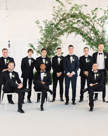wedding groomsmen group shot with greenery