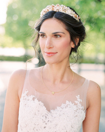 middle part hairstyles bride wearing gold and pearl crown