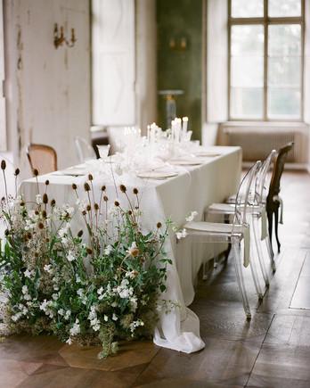 restaurant wedding ideas table with floor floral arrangement