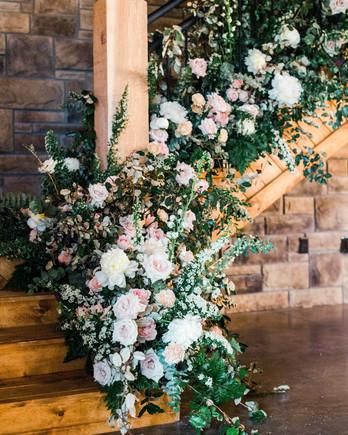 wood stairwell floral arrangement